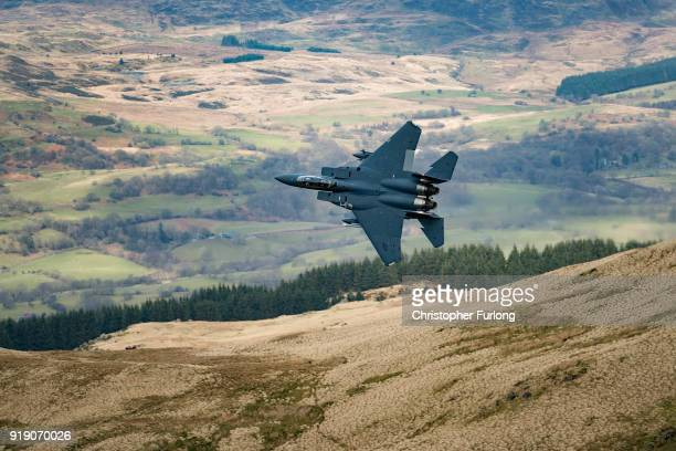United States Air Force F15 fighter jet based at RAF Lakenheath speeds through the Dinas Pass known in the aviation world as the Mach Loop on...