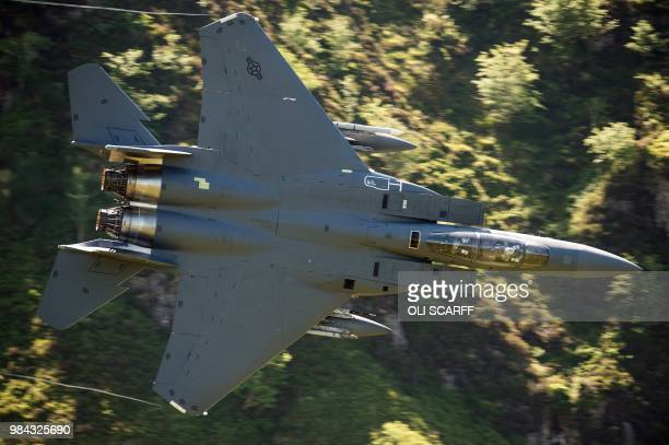 A United States Air Force F15 fighter jet travels at low altitude through the 'Mach Loop' series of valleys near Dolgellau north Wales on June 26...