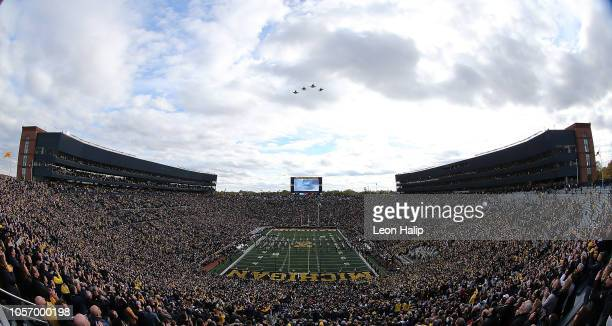 United States Air Force F16 fly over Michigan Stadium prior to the start of the game against the Penn State Nittany Lions on November 3, 2018 in Ann...