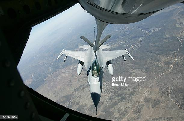 United States Air Force F16C Fighting Falcon gets fuel from a USAF KC135 air refueling jet as the aircraft participate in the Joint Expeditionary...