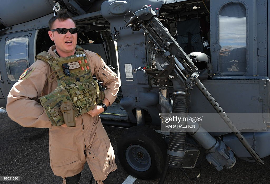 United States Air Force Flight Engineer Oswood, stands in front of his HH-60 Pave Hawk before a rescue operation during Exercise Angel Thunder, near the town of Bisbee in Arizona's Sonoran Desert on April 21, 2010. Exercise Angel Thunder simulates personnel recovery missions behind enemy lines and is the largest Department of Defense personnel recovery exercise to date. International observors from from Australia, Brazil, Canada, Chile, Colombia, Denmark, France, Germany, Netherlands, and United Kingdom took part in the event. AFP PHOTO/Mark RALSTON