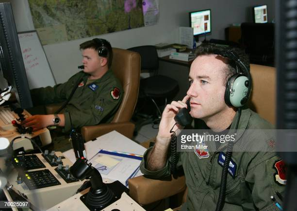 United States Air Force Maj Casey Tidgewell and Senior Airman William Swain operate an MQ9 Reaper from a ground control station August 8 2007 at...