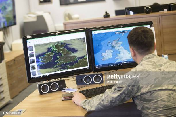 A United States Air Force officer monitors weather conditions over the UK and France on computer screens as the 48th Fighter Wing of the United...