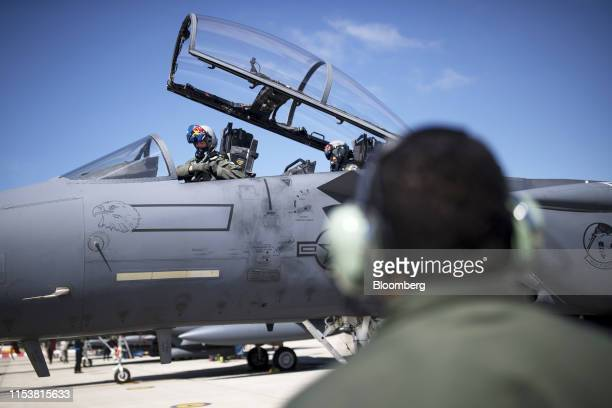 A United States Air Force pilot and a weapons systems officer sit in the cockpit of a Boeing Co F15E Strike Eagle combat aircraft ahead of take off...