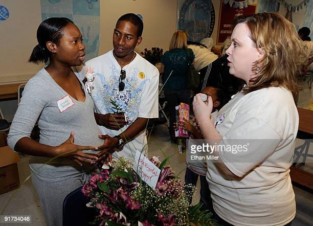 United States Air Force Senior Airman Crystal Bryant and her husband USAF Senior Airman Ishmael Bryant talk with organizer Jody Shervanick of...