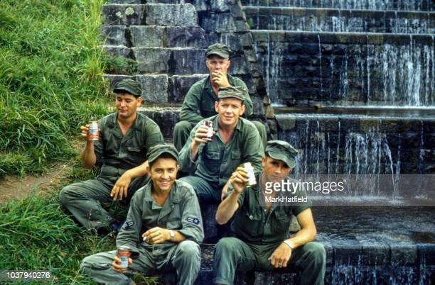 chinhae south korea - 1952 : united states air force soldiers pose with beer in south korea at the naval station during a leave. - korean_war stock pictures, royalty-free photos & images