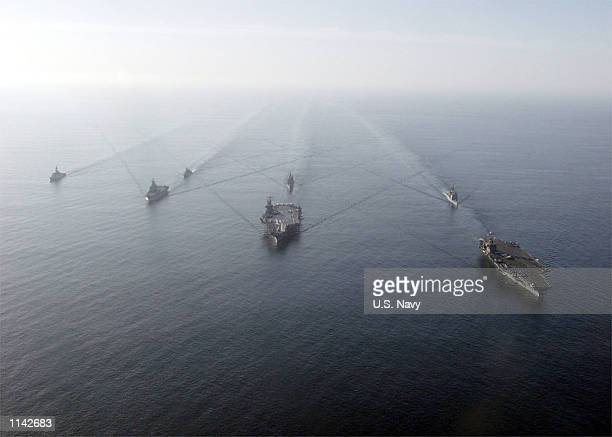 United States aircraft carriers USS Theodore Roosevelt, USS Carl Vinson, and guided missile cruisers USS Vella Gulf, USS Antietam are joined by the...