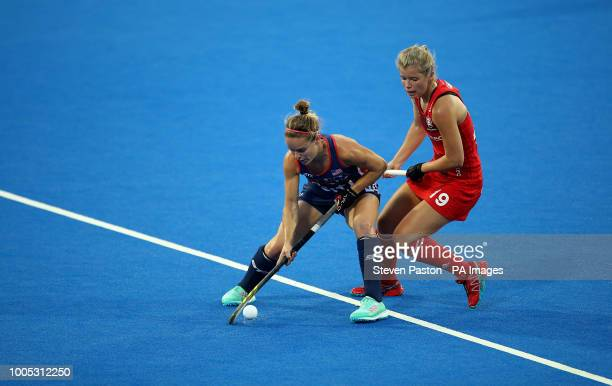 United States Alyssa Manley and England's Sophie Bray during the national Vitality Women's Hockey World Cup match at The Lee Valley Hockey and Tennis...