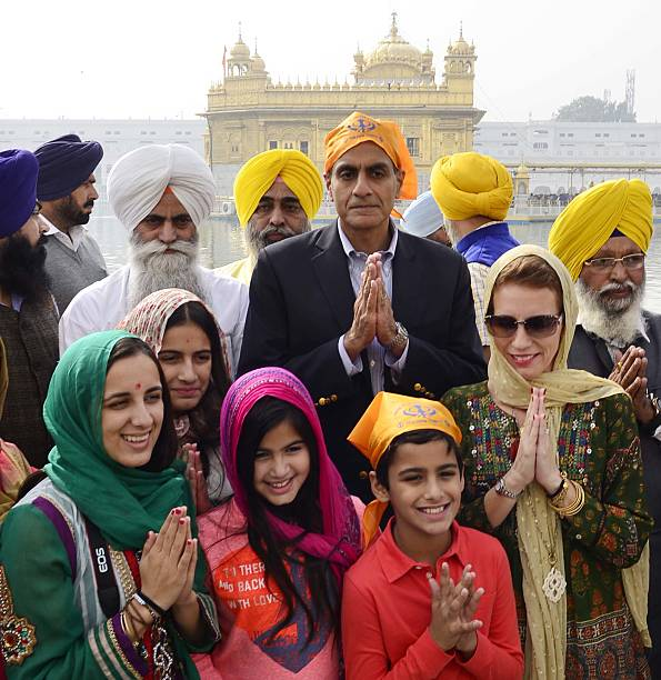 United States Ambassador to India Richard Verma along with family members pay obeisance at Golden Temple on November 23 2016 in Amritsar India