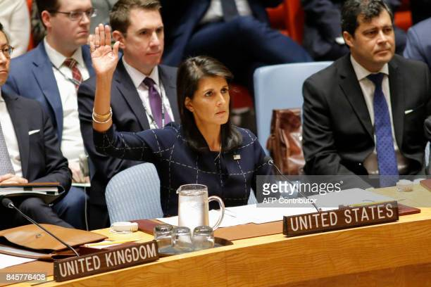 United States Ambassador to the United Nations Nikki Haley rises her arm as she votes at a UN Security Council meeting over North Korea's new...