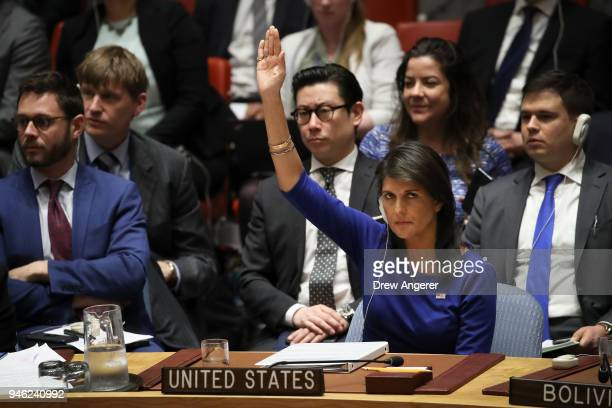 United States Ambassador to the United Nations Nikki Haley vetoes a Russian proposed draft resolution that would 'condemn the aggression against...