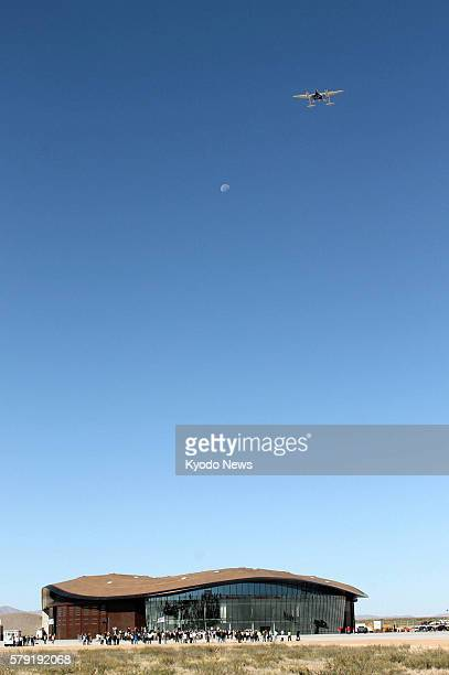 United States - An airplane carrying a spaceship soars through the sky over a newly completed spaceport for space tourism, named Spaceport America,...