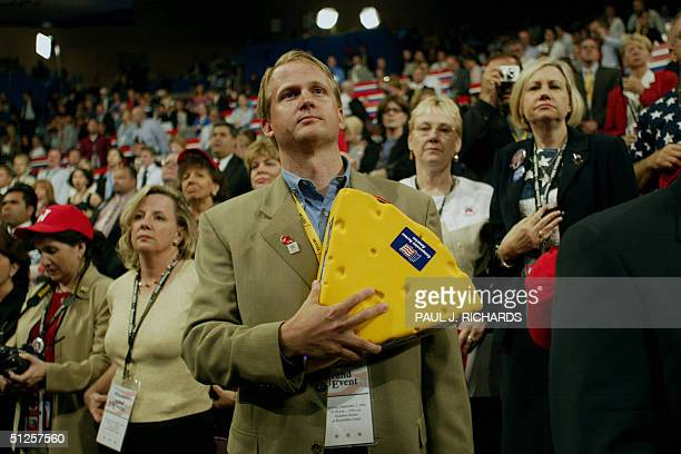 An unidentified delegate holds his cheesehead hat over his heart during the National Anthem at the Republican National Convention at Madison Square...