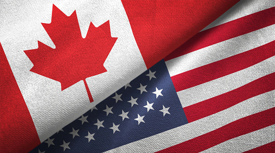 United States and Canada two flags together realations textile cloth fabric texture 1089931096