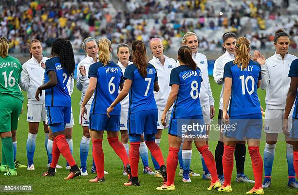 United States and France shake hands before the Women's Group G first round match between United States and France during Day 1 of the Rio 2016...