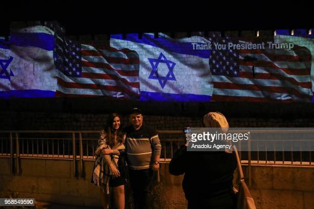 United States and Israeli flags are projected on fortification wall of the Jerusalem's old city on the day the US relocated its embassy from Tel Aviv...