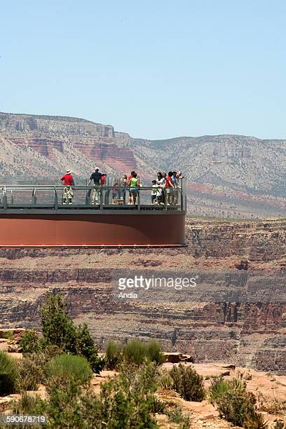 Arizona Grand Canyon National Park Group of tourists in the Grand Canyon national park Viewpoint panorama Skywalk in Eagle Point over the Colorado...