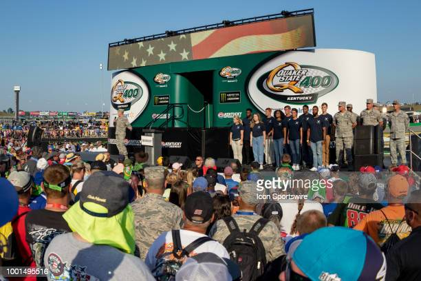 United States armed forces applicants repeat the oath of enlistment before the Monster Energy NASCAR Cup Series Quaker State 400 presented by Walmart...