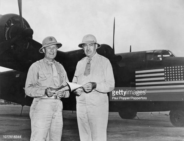 United States Army Air Forces General George Brett pictured on left with Colonel Caleb V Haynes as they stand together in front of a Consolidated B24...