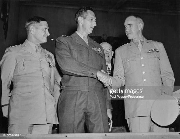 United States Army Generals, from left, Lieutenant General Geoffrey Keyes , General Mark W Clark and General Omar Bradley pictured together attending...