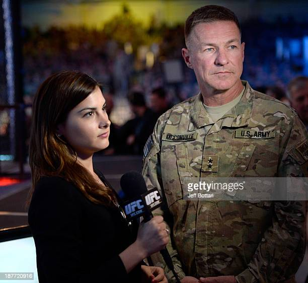 United States Army Major General James C McConville speaks UFC host and reporter Megan Olivi during the UFC Fight for the Troops event on November 6...