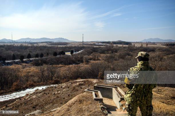 United States Army officer looks over the Demilitarized Zone between South and North Korea on February 7 2018 in Panmunjom South Korea In a sign of...