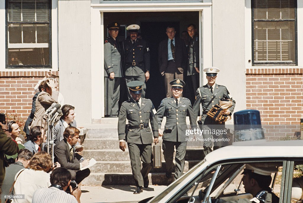 United States Army officer William Calley pictured leaving court, escorted by US military police personnel at Fort Benning in Georgia, United States on 31st March 1971 after being convicted of the premeditated murder of 22 Vietnamese civilians in the My Lai Massacre during the Vietnam War.