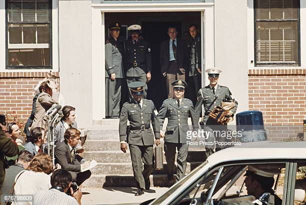 United States Army officer William Calley pictured leaving court escorted by US military police personnel at Fort Benning in Georgia United States on...