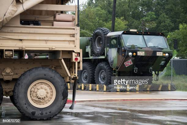 United States Army vehicles are seen stationed at the heliport of MCHD EMS Station 30 during Hurricane Harvey in Humble TX United States on August 29...