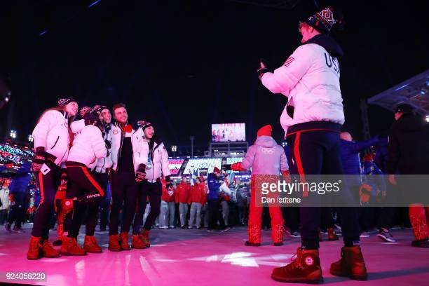 United States' athletes Bradie Tennell Madison Chock Adam Rippon Gus Kenworthy and Mirai Nagasu have their photo taken by Evan Bates during the...