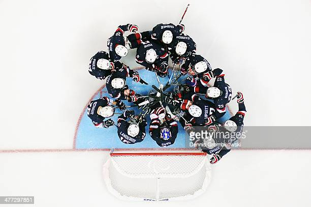 United States athletes huddle before the Ice Sledge Hockey Preliminary Round Group A match between the United States and Italy at Shayba Arena on...