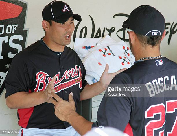ORLANDO United States Atlanta Braves pitcher Kenshin Kawakami talks with a teammate during spring training in Orlando Florida on March 20 2011...