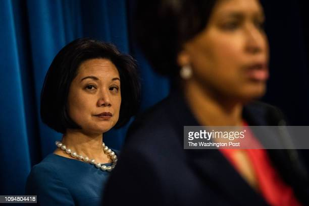 United States Attorney for the District of Columbia Jessie K Liu looks on as DC Mayor Muriel Bowser speak during a press conference on Wednesday...