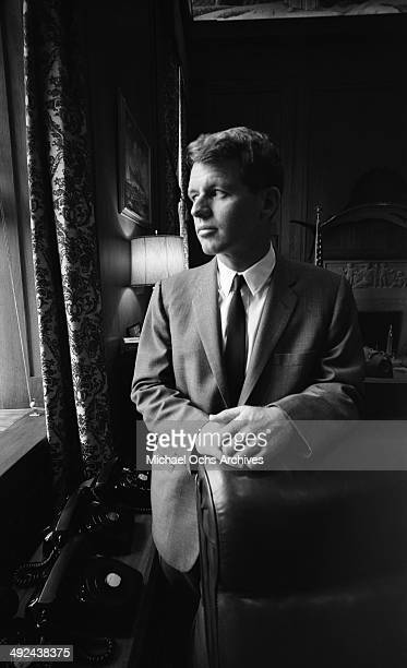 United States Attorney General Robert Kennedy poses for a portrait in his Justice Department office circa 1964 in Washington DC
