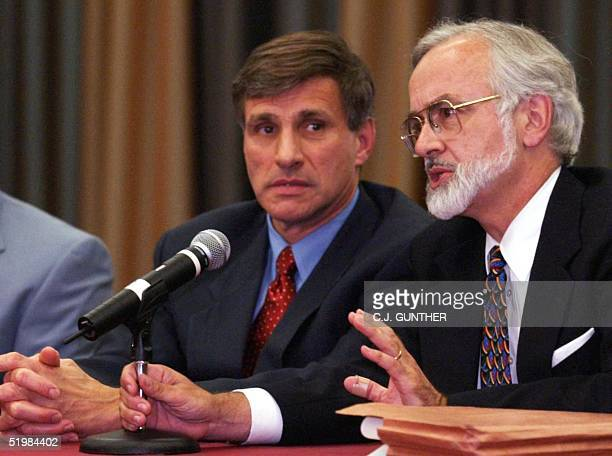 United States Attorney James B Farmer refuses to answer a reporter's question as the FBI's Special Agent in Charge Charles Prouty looks on during a...