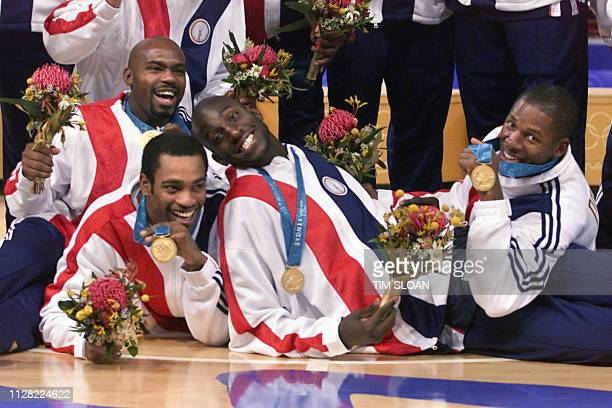 United States basketball players, from left, Tim Hardaway, Vince Carter, Kevin Garnett, and Ray Allen show their gold medals during the awards...