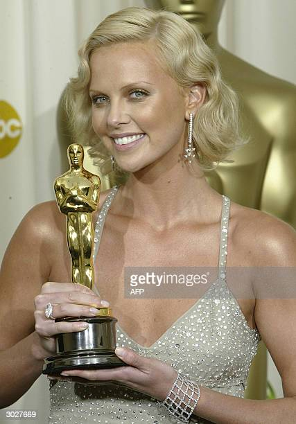 United States: Best Actress Charlize Theron poses with her trophy at the 76th Academy Awards ceremony 29 February, 2004 at the Kodak Theater in...