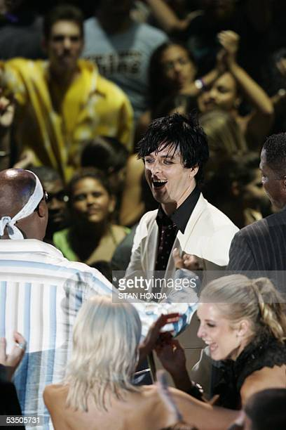 Billie Joe Armstrong of US group Green Day is congratulated by US rapper MC Hammer after Green Day won the video of the year award at the MTV music...