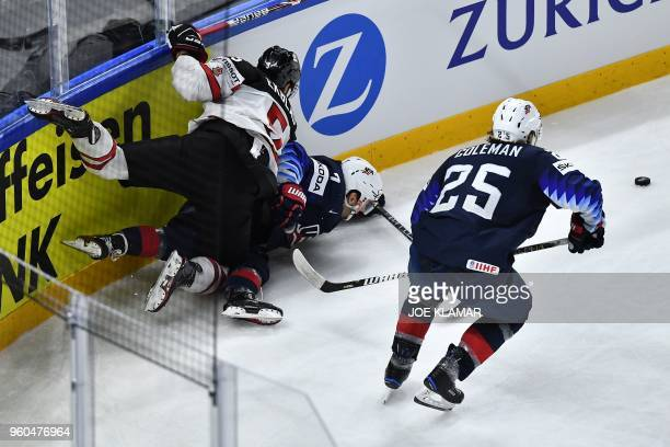 United States' Blake Coleman vies with Canada's Aaron Ekblad during the bronze medal match USA vs Canada of the 2018 IIHF Ice Hockey World...