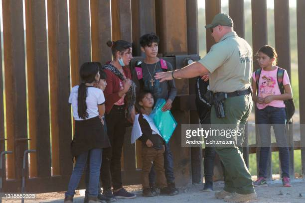 United States Border Patrol agents detain families from Central and South America who have been crossing into the United States from Mexico to ask...