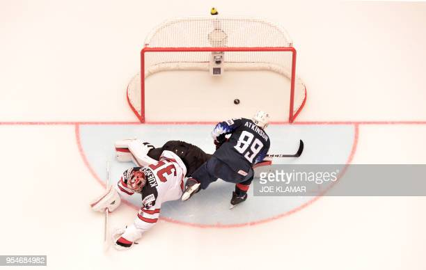 United States' Cam Atkinson scores for victory during the group B match US vs Canada of the 2018 IIHF Ice Hockey World Championship at the Jyske Bank...