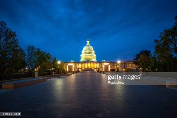 united states capitol, government illuminated at night in washington, d.c., united states of america. usa tourism, history building, or tradition culture and travel concept - president stock pictures, royalty-free photos & images