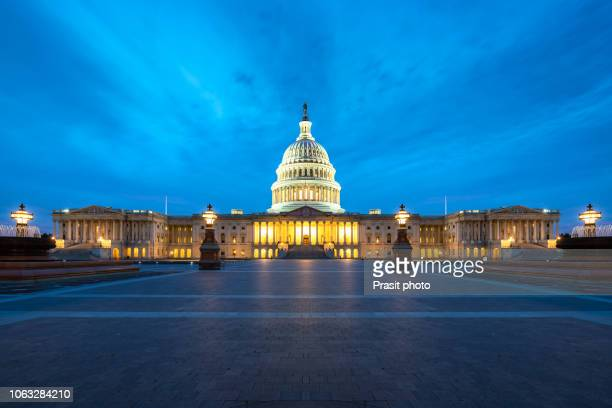 united states capitol, government in washington, d.c., united states of america. illuminated at night - legislation stock pictures, royalty-free photos & images