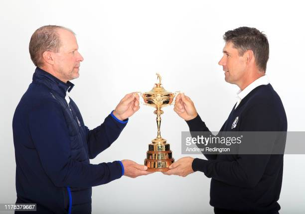United States Captain Steve Stricker and European Captain Padraig Harrington pose with the Ryder Cup during the Ryder Cup 2020 Year to Go media event...