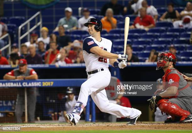 United States catcher Buster Posey grounds out as teammate third baseman Nolan Arenado scores during the first inning of a World Baseball Classic...