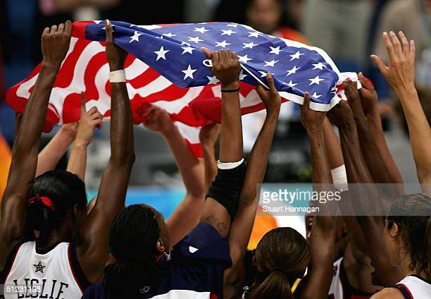 United States celebrate winning the gold medal in the women's basketball gold medal match between United States of America and Australia on August 28...