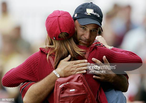 Chris DiMarco of the USA gets a hug from his wife Amy after alternate ball Foursome match play against the Internationals at the 2005 Presidents Cup...
