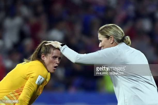 TOPSHOT United States' coach Jillian Ellis celebrates with United States' goalkeeper Alyssa Naeher at the end of the France 2019 Women's World Cup...