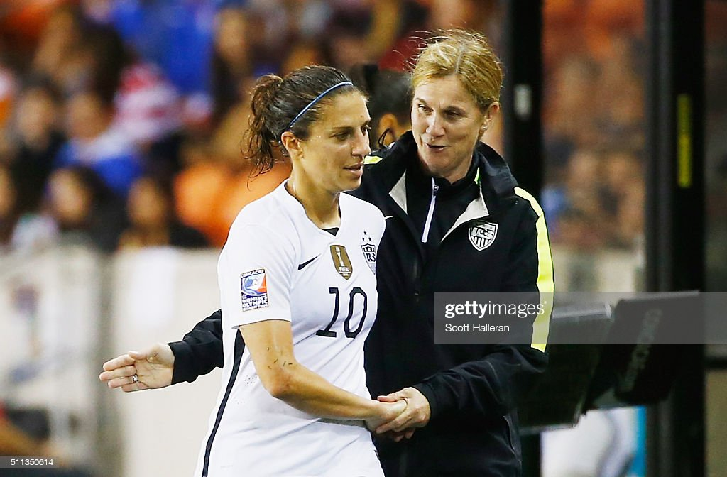 United States coach Jillian Ellis greets Carli Lloyd #10 as she leaves the the game against Trinidad and Tobago during their Semifinal of the 2016 CONCACAF Women's Olympic Qualifying at BBVA Compass Stadium on February 19, 2016 in Houston, Texas.