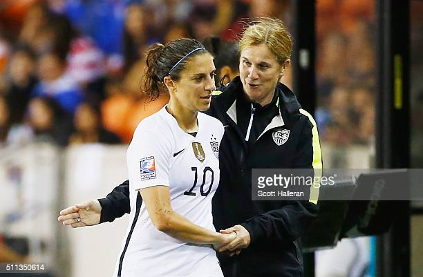 United States coach Jillian Ellis greets Carli Lloyd as she leaves the the game against Trinidad and Tobago during their Semifinal of the 2016...